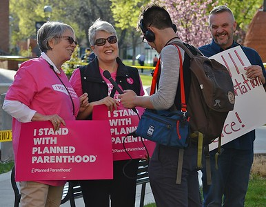 Radio news reporter interviewing two Planned Parenthood supporters.