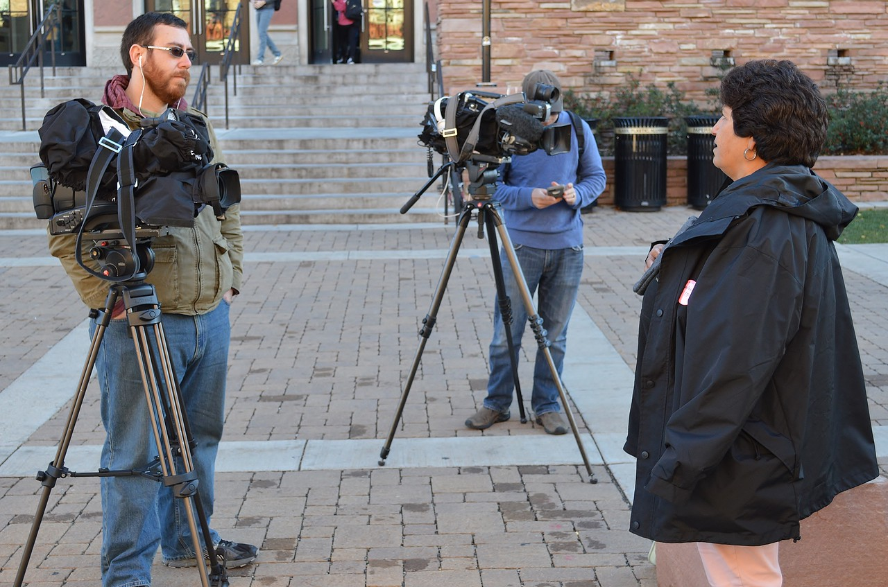 News media interviewing worker at union rally at CU-Boulder.