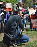 A photographer captures the action at a labor protest on May Day in Denver, Co.