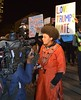 African American woman being interviewed at protest against Donald Trump.