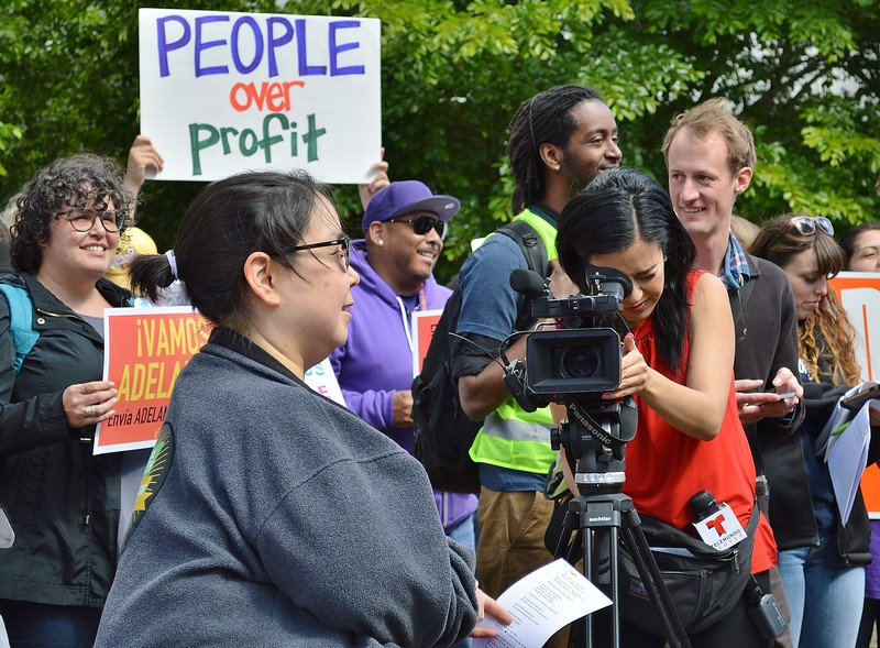 Reporter from the Denver Telemundo affiliate captures the action at a labor protest on May Day in Denver, Co.