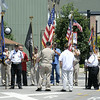 Don Knight   The Herald Bulletin<br /> A color guard stands across Anderson Street waiting for Airman Howard Martin to be returned to Elwood on Thursday. Hundreds turned out and lined Anderson Street to see Martin's processional.