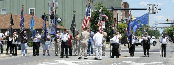 Don Knight | The Herald Bulletin<br /> A color guard stands across Anderson Street waiting for Airman Howard Martin to be returned to Elwood on Thursday. Hundreds turned out and lined Anderson Street to see Martin's processional.