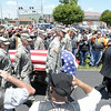 Don Knight | The Herald Bulletin<br /> Patriot Guard Riders salute as Airman Howard Martin returned to Elwood on Thursday. He was killed in 1952 when the C-124 Globemaster he was aboard crashed into Mt. Gannett killing all 52 aboard.