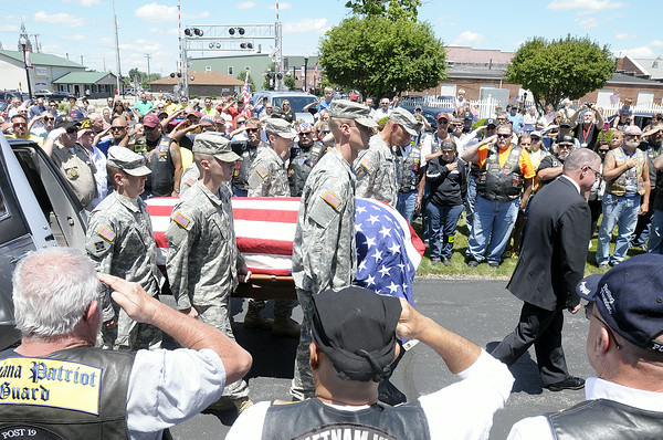 Don Knight   The Herald Bulletin<br /> Patriot Guard Riders salute as Airman Howard Martin returned to Elwood on Thursday. He was killed in 1952 when the C-124 Globemaster he was aboard crashed into Mt. Gannett killing all 52 aboard.