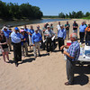 Tribune-Star file/Jim Avelis<br /> Right setting: John Goss, lower right, talks with members of the Wabash River Heritage Corridor Committee and The Nature Conservancy along with Indiana Department of Natural Resources employees about the silver, or Asian carp. The luncheon and meeting were held on a sand bar on the Wabash River in northern Vigo County in June of 2012.