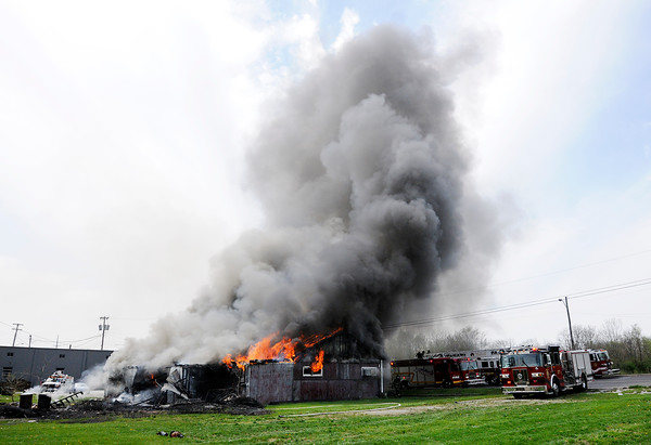 Don Knight | The Herald Bulletin<br /> Fire destroyed a storage building at Man4Man ministries on Tuesday.