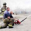 Don Knight | The Herald Bulletin<br /> AFD firefighters direct a nozzle at a fire that destroyed a storage building at Man4Man ministries on Tuesday. The department was on the scene for nearly 3 1/2 hours.