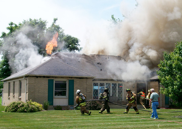 Firefighters from the Anderson, Lapel, Edgewood and Pendleton fire departments battled a blaze at a home at the corner of Laurel Lane and Central Way in Edgewood Thursday.