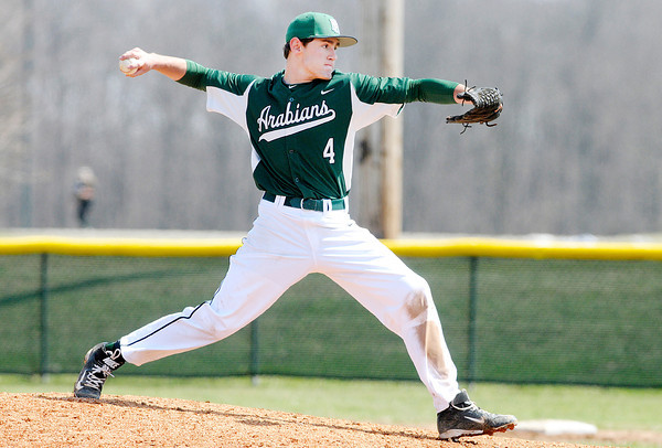 Don Knight | The Herald Bulletin<br /> Pendleton Heights' Austin MacMillan pitches as the Arabians hosted Greenfield-Central on Saturday.