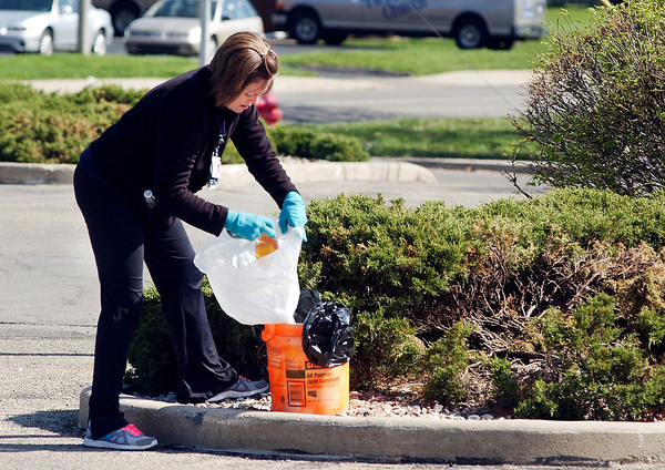 John P. Cleary   The Herald Bulletin<br /> The Environmental Stewardship Committee at St. Vincent Anderson Regional Hospital organized a campus clean-up effort on Earth Day Tuesday where about 25 volunteers took part.  Here Lesley Patterson bags up old plastic bottles found in the bushes near 23rd and Jackson Streets. To view or buy this photo and other Herald Bulletin photos, visit<br /> heraldbulletin.smugmug.com.