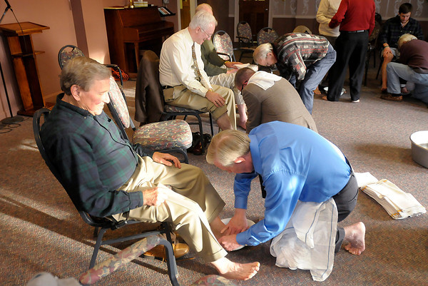 Don Knight   The Herald Bulletin<br /> David Coolidge washes the feet of Bill White as Park Place Church of God concluded their Maundy Thursday service with a foot washing. The evening also included a Seder Meal and Communion.