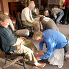 Don Knight | The Herald Bulletin<br /> David Coolidge washes the feet of Bill White as Park Place Church of God concluded their Maundy Thursday service with a foot washing. The evening also included a Seder Meal and Communion.