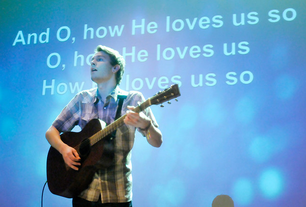 Don Knight | The Herald Bulletin<br /> Ethan Utterback plays guitar during the Ignite service for high school students at Madison Park Church of God on Wednesday. The church has emerged from bankruptcy after renegotiating its debt payments.