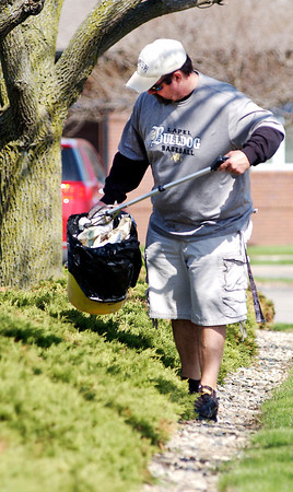 John P. Cleary | The Herald Bulletin<br /> The Environmental Stewardship Committee at St. Vincent Anderson Regional Hospital organized a campus clean-up effort on Earth Day Tuesday where about 25 volunteers took part.  Here volunteer Jeffery Ash picks trash out of the shurbs. To view or buy this photo and other Herald Bulletin photos, visit<br /> heraldbulletin.smugmug.com.
