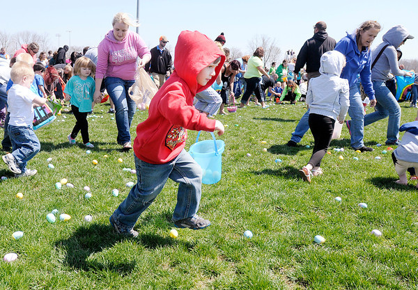 Don Knight | The Herald Bulletin<br /> Children fill their Easter baskets with eggs on the football field at Lapel High School during The River Church's annual Egg Drop on Saturday. To view or buy this photo and other Herald Bulletin photos, visit heraldbulletin.smugmug.com.
