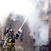 John P. Cleary | The Herald Bulletin<br /> Anderson firefighters battled a house fire that destroyed the garage and did heavy smoke damage to the rest of the house in the 2600 block of Highland Road.