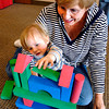 John P. Cleary | The Herald Bulletin<br /> Ty Coyle, 2, reaches up to place another block on his stack as grandmother Jane Coyle encourages him along during a Block Party for young children at the Pendleton Library Thursday morning.<br /> To view or buy this photo and other Herald Bulletin photos, visit<br /> heraldbulletin.smugmug.com.