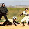 Chris Martin | For The Herald Bulletin<br /> Madison Grant's Kaylay Stanley beats the throw back to first against Pendleton Heights in the County Tournament. To view or buy this photo and other Herald Bulletin photos, visit heraldbulletin.smugmug.com.