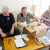 Don Knight | The Herald Bulletin<br /> Richard Goff, center, delivers medical items to Leuis Moyer, left, as April Zimmerman looks on.