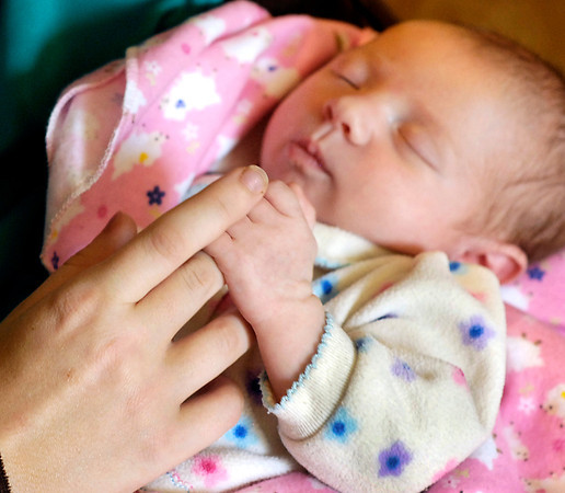 John P. Cleary | The Herald Bulletin<br /> Autumn Marie grasps on to her mothers' finger while sleeping.