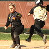 Photo by Chris Martin<br /> Madison Grant's Kayla Stanley cannot beat out the throw at 1st against Alexandria Wednesday