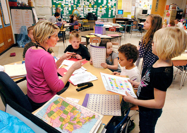 John P. Cleary   The Herald Bulletin<br /> Alexandria-Monroe Elementary School first grade teacher Kimberly Osterhoff gives her students instructions Monday on their first day back in the classroom from spring break.