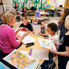 John P. Cleary | The Herald Bulletin<br /> Alexandria-Monroe Elementary School first grade teacher Kimberly Osterhoff gives her students instructions Monday on their first day back in the classroom from spring break.
