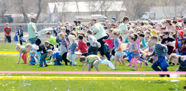 Don Knight | The Herald Bulletin<br /> Children run onto the field at Lapel High School in search of Easter Eggs during <br /> The River Church's annual Egg Drop on Saturday.