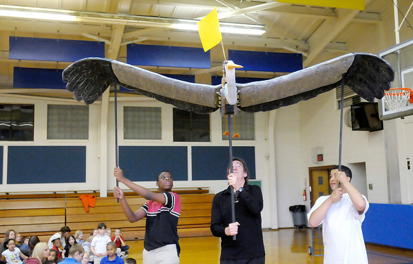 Don Knight | The Herald Bulletin<br /> Doug Berky, center, demonstrates his blue heron puppet with help from Nataveon Caywood left and Nate Burnett for the students in the Park Place Community Center's after school program on Thursday. To view or buy this photo and other Herald Bulletin photos, visit heraldbulletin.smugmug.com.