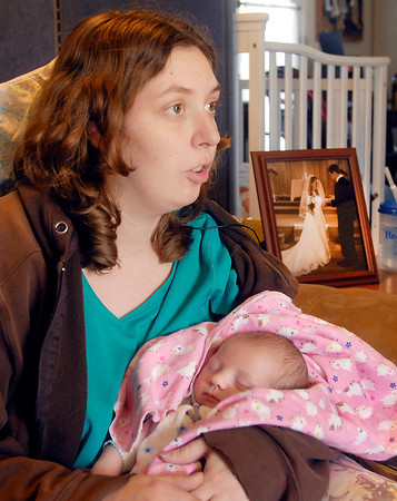 John P. Cleary | The Herald Bulletin<br /> Rebecca Sperry, holding her daughter Autumn Marie, talks about her late husband Jesse and the accident that killed him from her parents home Wednesday where she is staying while recuperating from her injuries from the accident.