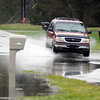 John P. Cleary | The Herald Bulletin<br /> Standing water was filling yards and then running across Van Buskirk Road in the Grandview addition Thursday.
