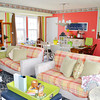 Bright coral and green shades in the living room create the feeling of<br /> spring – even in the dead of winter.