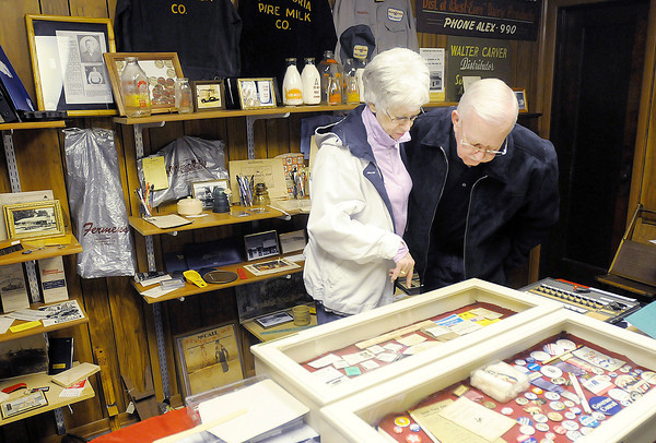 Don Knight | The Herald Bulletin<br /> Darlene and Dennis Stansberry look over the collection at the Alexandria-Monroe Historical Museum during its opening on Saturday. The reopening included Spanish Burgers made with a recipe closely resembling the burgers when they were served at the Tiger Inn.