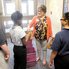 "Don Knight | The Herald Bulletin<br /> Community Hospital volunteers Pat Woods hands out ""buddy bags"" to students at Anderson Elementary on Friday. Community hands out bags once a month and First United Methodist Church hands out bags twice a month."