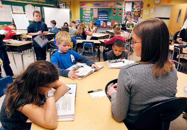 John P. Cleary | The Herald Bulletin<br /> Alexandria-Monroe Elementary School second grade teacher Jennifer Kuhn works with students on their reading lessons Monday.