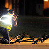 Don Knight | The Herald Bulletin<br /> The Madison County Sheriff's Department accident investigation team documents the scene of an accident involving a van and a bicyclists on Scatterfield Road Friday evening.