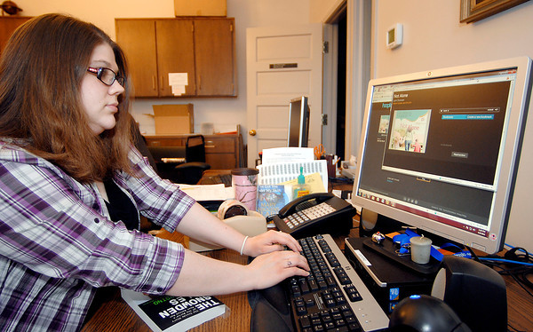 John P. Cleary | The Herald Bulletin<br /> Alexandria-Monroe Library has new digital service to rent digital books & music.  Here Rachael Metz, a cataloger at the library, utilizes the service to listen to books as she catalogs all day.