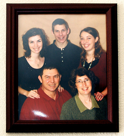 John P. Cleary | The Herald Bulletin<br /> A photo of the Keefe family, with Rebecca on the back right, on the wall at Rebecca's parents house.