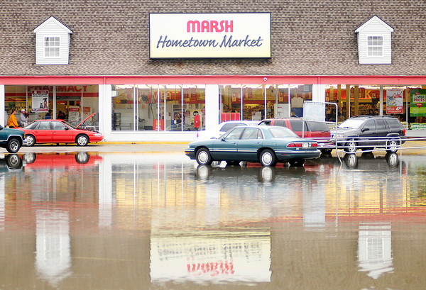 Don Knight   The Herald Bulletin<br /> The Marsh parking lot on Nichol Avenue flooded following heavy rains on Thursday. More heavy rain is forecast for overnight and Friday morning.