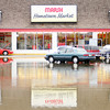 Don Knight | The Herald Bulletin<br /> The Marsh parking lot on Nichol Avenue flooded following heavy rains on Thursday. More heavy rain is forecast for overnight and Friday morning.