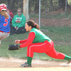 Photo by Chris Martin<br /> Elwood's Ashley Kleinbub beats out the throw for a single against Anderson in the County Tourney