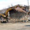 John P. Cleary | The Herald Bulletin<br /> Workers from Shroyer Brothers Inc. of Muncie started demolition of the old The Great Northwest Watering Hole building at CR 500E and CR old 67 in Chesterfield Monday morning.  The building, which as been several things over the years including Story's Truck Stop, JC's County Line and then the Northwest Watering Hole, has been vacant for years with the building deteriorating.