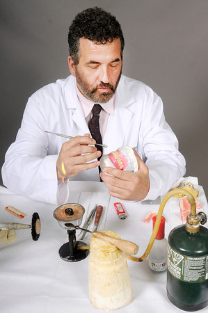 Don Knight | The Herald Bulletin<br /> Mark Funderburk demonstrates how he creates dentures. Funderburk credits his father Dr. Gerald Funderburk for his success in the dental field.