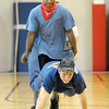 Don Knight | The Herald Bulletin<br /> Michael Paul walks on his hands as Michael Paul carries his feet during a wheel barrel race at Highland Middle School. Highland's Success Academy  hosted their second annual ISTEP+ Olympic event on Friday. Students were divided into teams and given an ISTEP+ review question at the start of each event. Teams who come up with the correct answer were given a slight advantage. To view or buy this photo and other Herald Bulletin photos, visit<br /> heraldbulletin.smugmug.com.