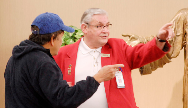 John P. Cleary | The Herald Bulletin<br /> Red coat volunteer Brian Morson gives directions at St. Vincent Regional Hospital in Anderson. Morson has volunteered more than 4,500 hours at the hospital