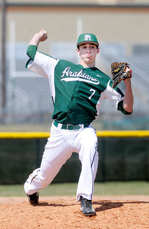 Don Knight | The Herald Bulletin<br /> Pendleton Heights' pitcher Quentin Miller attempts to pick off a base runner at first base as the Arabians hosted Greenfield-Central on Saturday.