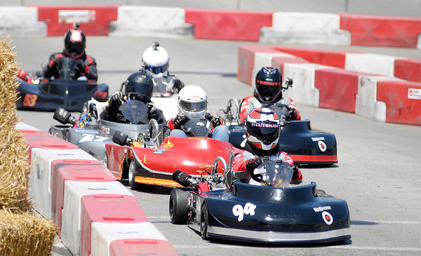 Don Knight | The Herald Bulletin<br /> Races in the Clone Lights division exit turn one during the Sertoma Club 20th Annual Mayor's Cup Grand Prix on Saturday. To view or buy this photo and other Herald Bulletin photos, visit heraldbulletin.smugmug.com.
