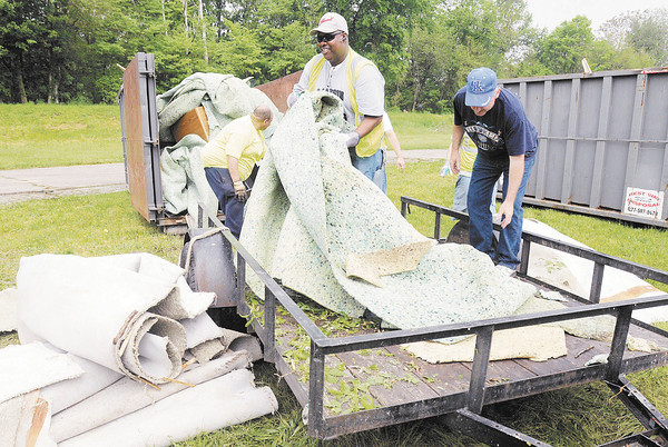 File photo | The Herald Bulletin<br /> Carpet and padding is unloaded from a trailer during the 28th Annual J.T. Menifee City-wide Cleanup in 2013.