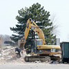 Don Knight | The Herald Bulletin<br /> Demolition of the former Holiday Inn north of I-69 began on Thursday. The Tom Wood dealership north of town will relocate to the location.